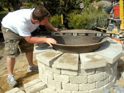 "Use Cast Iron Kettle for ""firepit"" - love the way it is in the corner of this stone wall.  Cool  - somewhere around the pool???"