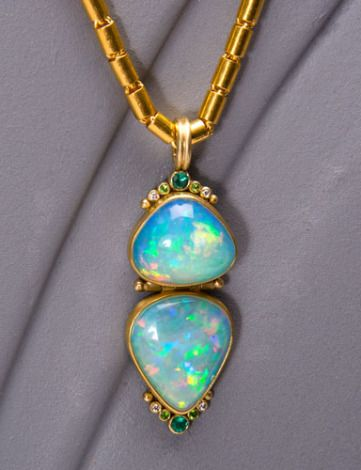 """Spectacular Ethiopian opals 17.49 ctw. are framed in 22kt gold and ornamented with sea foam Paraiba tourmalines .17 ctw., demantoid garnets .04 ctw., and white diamonds .04 ctw.    Approximate length: 2.25""""   Chain sold separately.   See chains"""