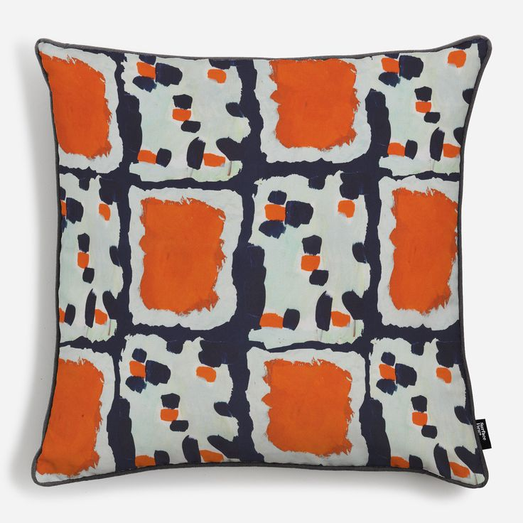 'Dominoes' designed by Charlotte Beevor. Inspired by abstracted blocks and dots of colour, the tangerine orange and navy blue balance perfectly.