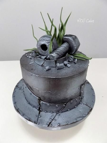Iron cake  by MOLI Cakes