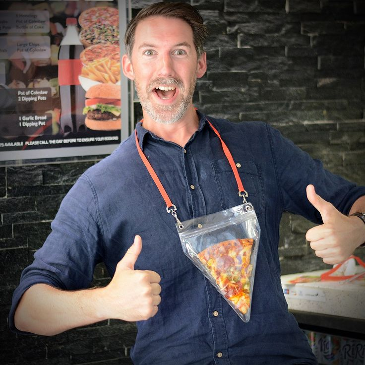 The Pizza Holder Pouch - All my life I've been searching for a way to carry my all-time favourite handheld food around, without worrying about dripping sauce or cheese sliding off. Now I can finally go about my daily business with a slice of pizza in tow, on hand whenever I need a bite of cheesy goodness. How did I exist before the pizza holder.