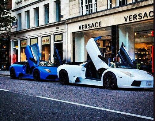Blue matt Lamborghini marcillago and white Lamborghini roadster in london