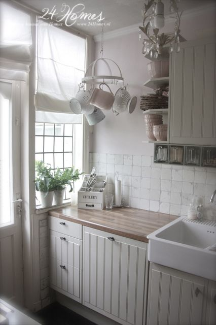 .Love the small hanging rack, its perfect for this corner and the small-paned window is wonderful