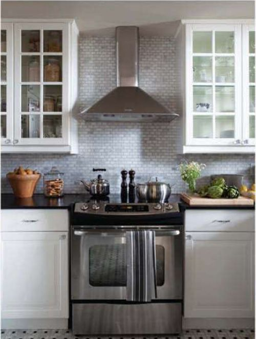 A great example of ceiling to countertop tile.  I like that they didn't cheap out on this.