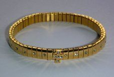 Gold Stretch Diamante Cross Bracelet.