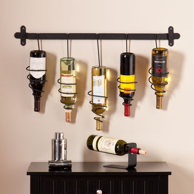 This unique Upton Home wall mount wine rack features five coil holders to store bottles upside down showing off your favorite labels. The natural, wrought iron finish gives this wall mount a charmingly industrial touch.