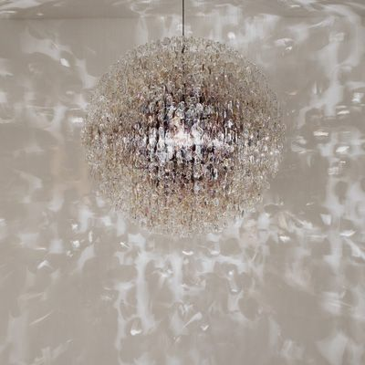 """Stuart Haygarth - """"OPTICAL'' (2007). The Optical chandelier is created from over 4500 prescription spectacle lenses."""