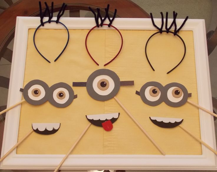 Minion photo props - use foam sheets, dowel rods, and headbands with pipe cleaners for the hair.  And an open frame to look through!