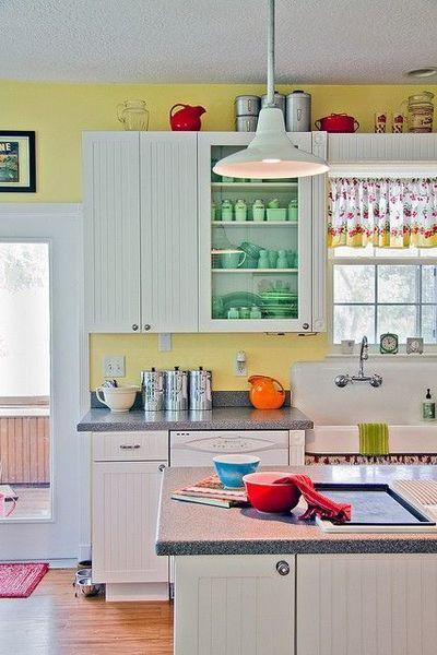 Cheery yellow vintage kitchen. Love the sink, jadeite, Pyrex :)