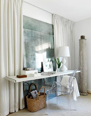 Home Office Heaven. In a small master bedroom, a floating desk and Louis Ghost chair keep bulky and leggy furniture to a minimum. Interior Designer: Lindsey Bond. Photographer: Jonny Valiant.