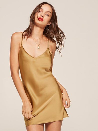 On my way. This is a loose fitting, mini length dress with a v neckline and adjustable straps.