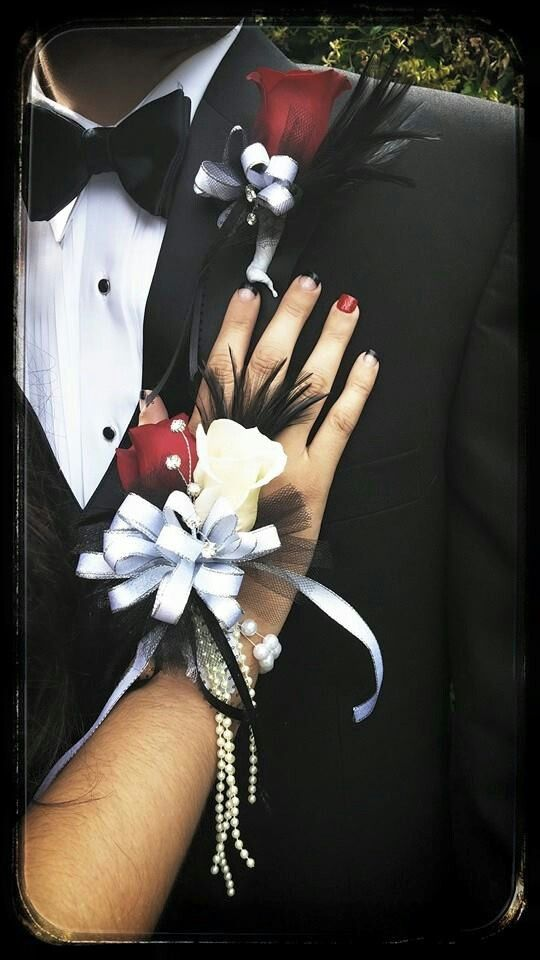 2 pc red rose silk prom corsage , silk wedding corsage. You can order this through the website, or you can find us on Facebook www.honestlysweetgifts.com