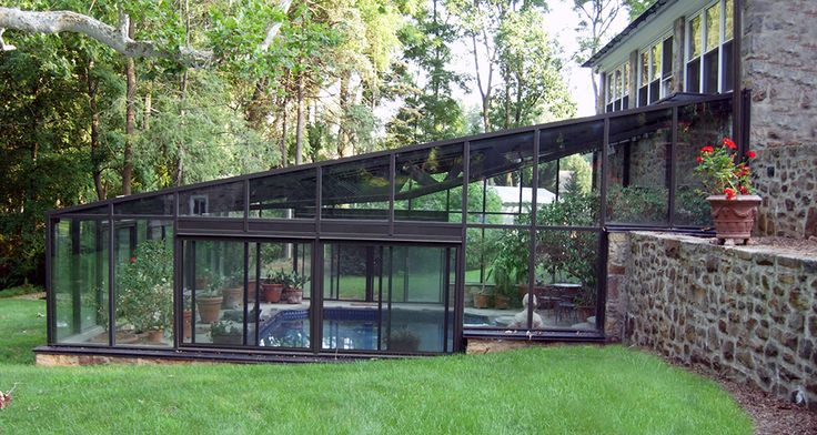Use a contemporary glass structure to enclose a pool for year-round swimming!  #modern #architecture