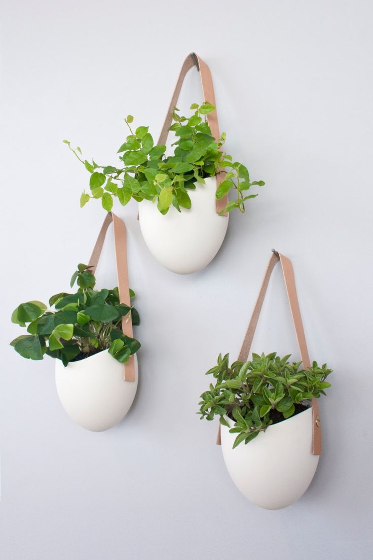Set of 3 porcelain and leather hanging containers. $135.00, via Etsy.