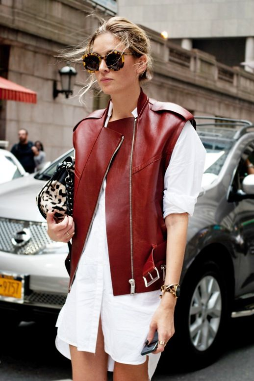 Camille Charrière effortlessly elevates her white shirtdress by styling it with an edgy burgundy leather vest. A versatile vest like this will stylishly take you through the entire spring season.
