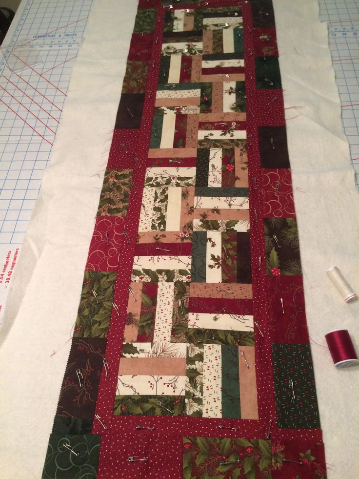 A Christmas table runner still patiently waiting to be quilted.