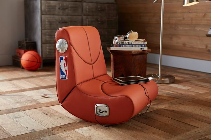 Kick back in this comfy chair before you press 'play'. Compatible with your favorite hand-held and desktop electronic devices, this rocking chair with built-in speakers is a must for gaming parties, movie viewing and more. And while supplies last, we'll donate a portion of the purchase price directly to NBA© Cares community partners to address important social issues focused on education, youth and family development and health and wellness while inspiring play.