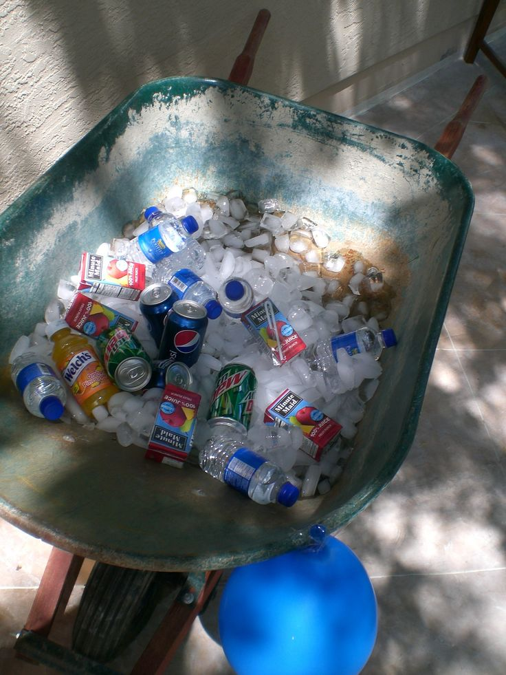 Wheelbarrow drink container (JoyandDelight.com): Make a wheelbarrow into a beverage holder; set drinks on top of ice; fun for a farm / barnyard party, garden birthday theme, John Deere theme, and more!
