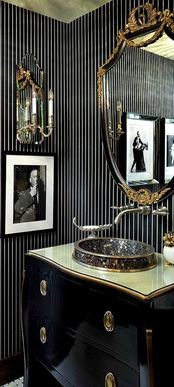 Art Deco Powder Room with Powder room, limestone tile floors, Vessel Sink, Inset cabinets, Wall sconce, interior wallpaper