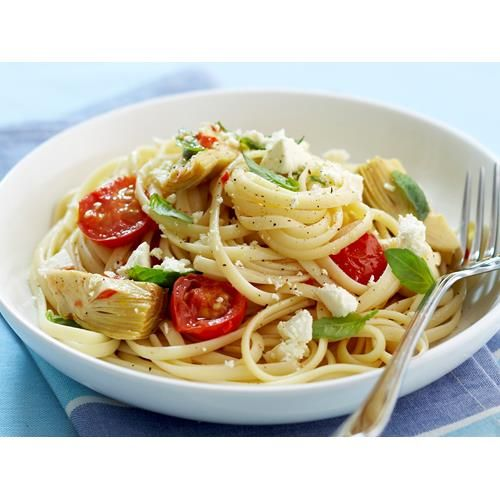 Fettuccine with artichokes and tomatoes recipe - By Woman's Day, This light and zesty fettuccine is bursting with the flavours of juicy cherry tomatoes, nutty artichokes, crumbly feta and a touch of basil.