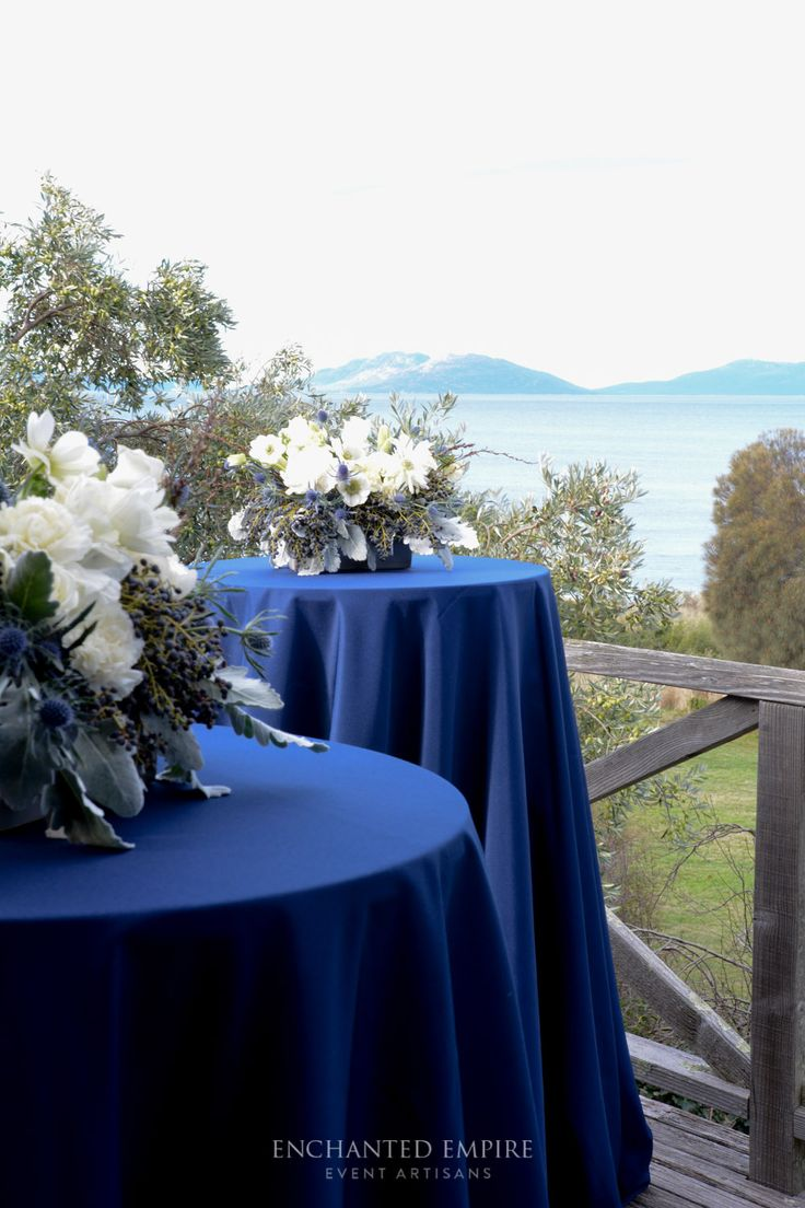 Intimate engagement styled to suit the Eastern Tasmania Coastline. Beautiful sunsets and rugged beaches were fashioned with a simplistic seaside palette. Styled with a beautiful dove grey tablecloth adorned with stunning arrangements of crisp white florals and dusty grey foliage. Custom navy menus designed in house were complimented by the individual guest acrylic custom place cards in elegant fonts and dove grey colouring See our full film on our You Tube Channel…