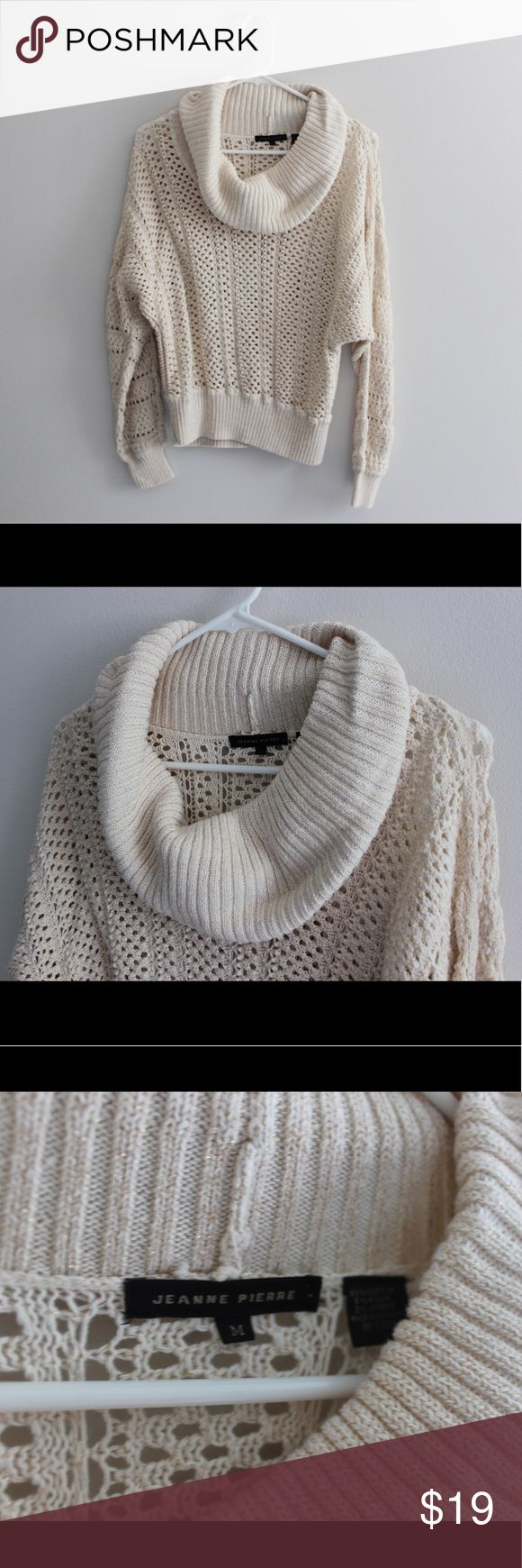 Cozy Cowl Neck Sweater This cozy cowl neck sweater is just what you need for fireside nights this fall/winter season. The cream fabric goes with everything and had gold laced throughout. Sweaters Cowl & Turtlenecks