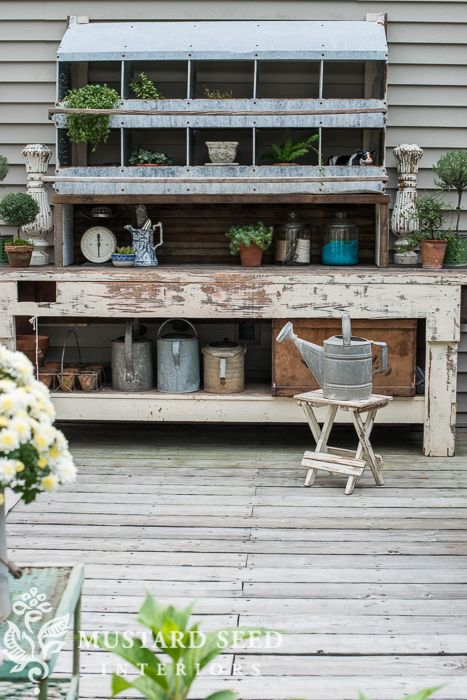 Vintage-style deck makeover with a hodge-podge potting bench made out of an old worktable (free) and a $95 chicken roosting box.
