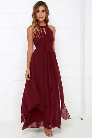 Dream Girl Wine Red Maxi Dress you won't want to wake up! Elegant chiffon in a lovely wine red hue shapes a high, halter neckline above a sleeveless pin-tucked bodice embellished by a front keyhole. Panels of chiffon flutter atop the sweeping maxi skirt as it falls effortlessly from a fitted, empire waist. Back keyhole has two-button closure. Hidden zipper/hook clasp at back. Fully lined. Self: 100% Polyester. Lining: 95% Polyester, 5% Spandex. Dry Clean Only. Imported.