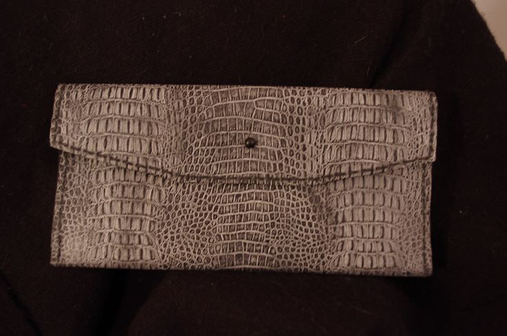 Gray pressed leather clutch.