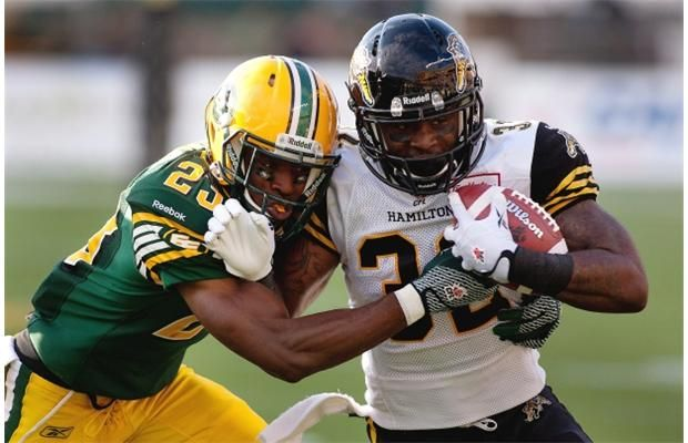 Edmonton Eskimos Marcell Young tackles Hamilton Tiger-Cats C.J. Gable during first half action at Commonwealth Stadium in Edmonton on August 2, 2013