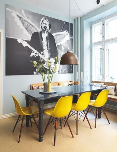 The soft blue walls and bright yellow chairs make this dining area fun and…