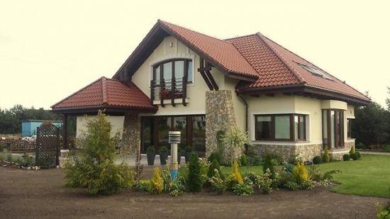 Constructie casa cu mansarda acoperita cu tigla