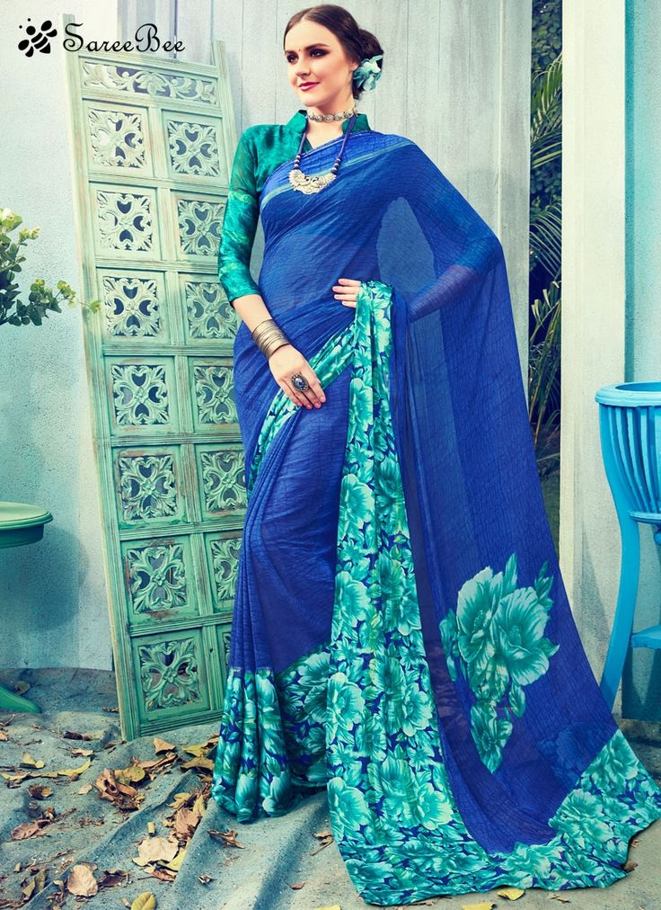 Dashing Satin Print Work Printed Saree  Ravishing attire to enhance your beauty. Make an adorable statement in this smashy blue satin printed saree. The print work looks chic and perfect for any occasion. Comes with matching blouse.
