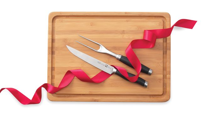 """For The Carnivore: A """"Pin It To Gift It"""" exclusive gift set: Our Forged Carving Knife and Fork bundled with the Reversible Bamboo Carving Board.  Shop now or join my team @ www.pamperedchef.biz/emileeskitchen, join me on Facebook  Emilee's Pampered Chef Kitchen.  Contact me to get some FREE :)"""