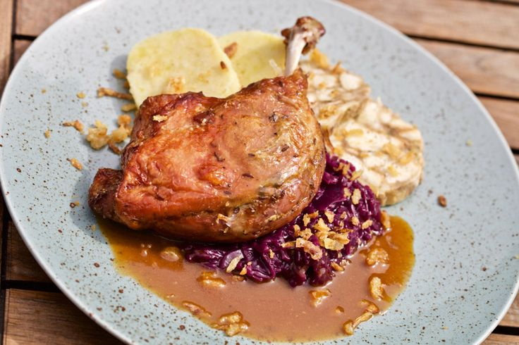 ROASTED LEG OF DUCK with fragrant red cabbage and a selection of dumplings