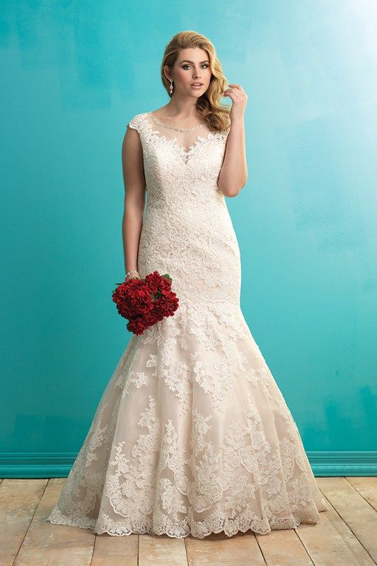 W364 Allure Women Bridal Gown - Illusion netting and a sprinkling of flowers soften this fitted bridal gowns deep neckline.