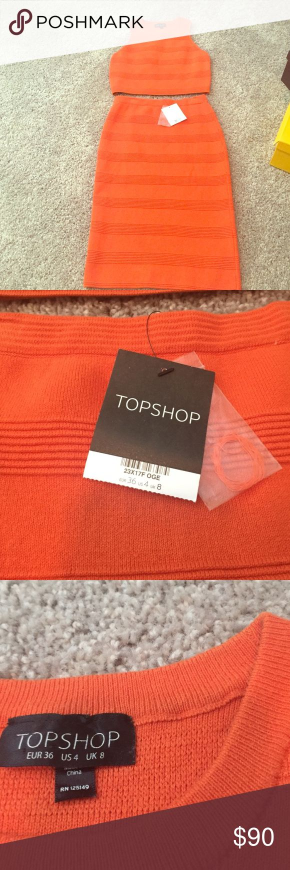 Size 4 Orange TOPSHOP crop shell and mid skirt Skirt (never been worn tag still on ) and crop top worn once) Orange size 4 TOPSHOP sweater material.  So cute on but I don't fit it. Originally $150 together but will sell both $90 together. Tag still on skirt, top worn once. Topshop Dresses Midi