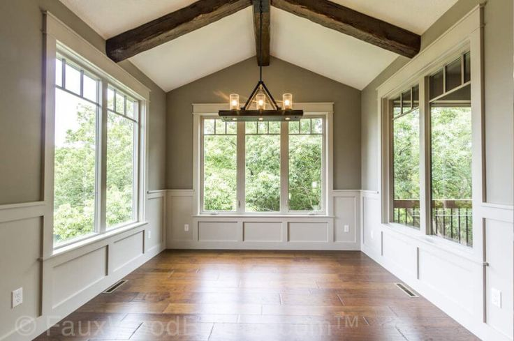 The vaulted ceiling of this sunroom is an excellent place for faux beams. Faux beams mean that you won't have to install extra supports, as solid wooden beams are incredibly heavy.