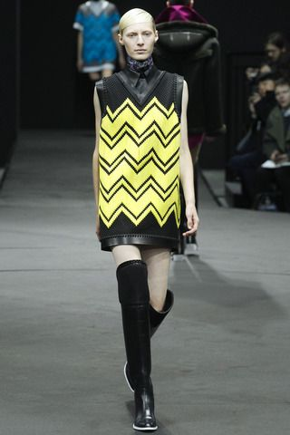 Charlie Brown sweater vet over leather sleeveless shirt dress with the continuation of the Wang oxford meets wader over the knee boot is a style brilliant yes for Fall.  Alexander Wang Fall 2014 Ready-to-Wear Collection Slideshow on Style.com
