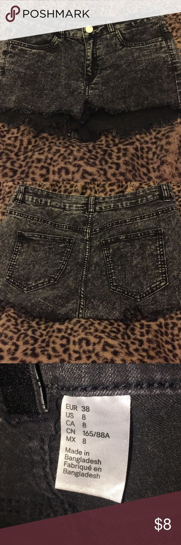 Black acid wash Jean shorts size 8 Acid wash stretch Jean shorts size 8 but fits like a size 2-4. Black and distressed Shorts Jean Shorts
