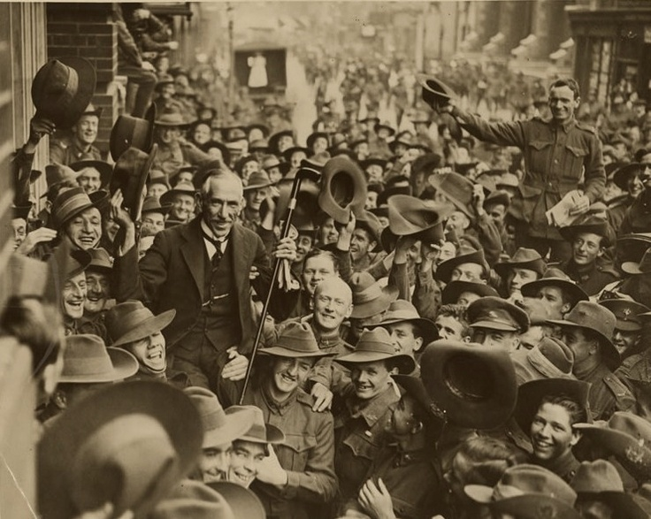 Australian soldiers carry 'the little digger' (Australian Prime Minister Billy Hughes) along George Street, Sydney in triumph after the Prime Minister returned from the Paris Peace Conference in 1919. (Australian National Archives)