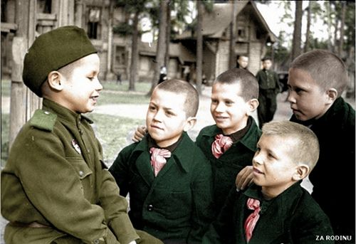 Very young Soviet soldier 1945 tells orphans about his combat experiences
