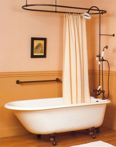 Clawfoot Tub with Shower Enclosure. Always wanted one of these bathtubs!