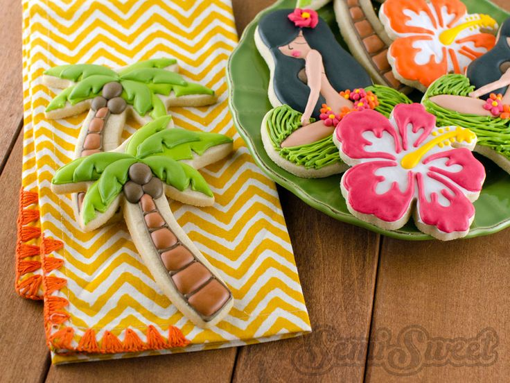 A tutorial on how to decorate whimsy palm tree cookies with royal icing, as well as a layered effect to add dimension.