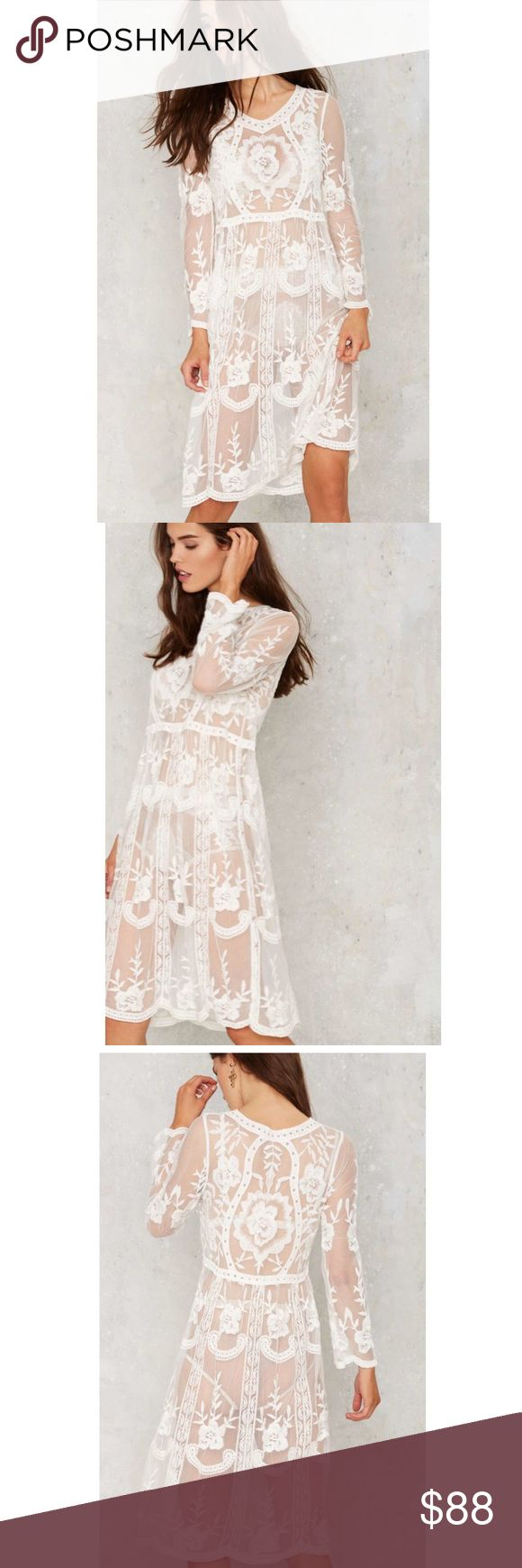 Tavia lace midi dress. Sheer from the norm. The Tavia Dress is made in sheer white crochet lace and features a slight v-neck, flare at waist, pullover design, and midi silhouette.  Perfect for a night out or for a brunch date.  Never worn! Nasty Gal Dresses Mini