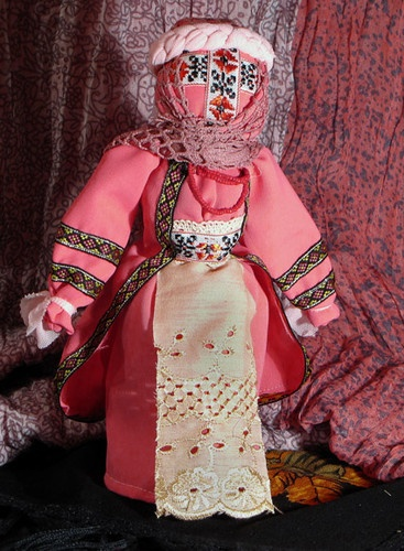Motanka-doll is a Ukrainian people's doll, symbol of women's wisdom and family bounds. Motanka is made by winding only, it has no face and keeps the warmth of people's hands, love and care with which it's made. Not by chance has motanka-doll no face. It is either faceless or there is a cross in the place of the face representing the solar sign, the symbol of the Sun. It is believed to be a symbol of well-being and a very strong charm.