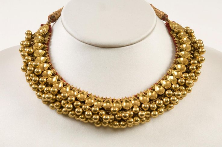 A gold necklace. India, Rajasthan, late 19th century. Provenance: A gold necklace, this bold design is typical for the heavy jewellery worn by the tribal women of the Rajasthani desert
