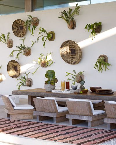 Cabana Dining area: the teak table and chairs were designed by Bonetti Kozerski Studio; Zambian baskets and staghorn ferns hang on the wall, and the rug is Moroccan.