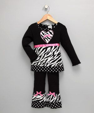 Bring your little ones along to your parties! This cheerful tunic is sure to become the life of the wardrobe thanks to its fancy appliqué and pretty mix of prints.