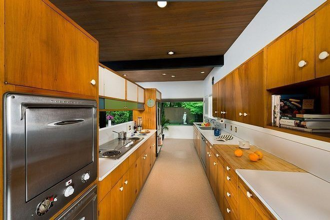 Built-in cutting board; hanging cabinets which is a hallmark of MCM kitchens; round drawer pulls; steel / chrome appliances. Another fine galley kitchen in a 1955 midcentury jewel in Spokane, WA.